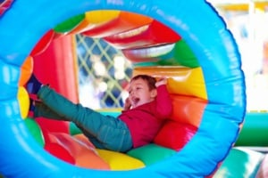 happy kids playing on inflatable attraction playground